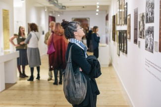Woman looking at exhibition at the Broadway Gallery