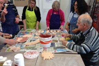 Members of Jackies Drop In, Letchworth, enjoy a clay workshop provided by Digswell Arts Trust
