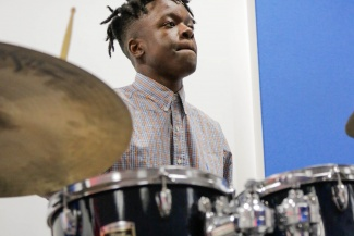 Morgan Simpson, a grant recipient, plays the drums