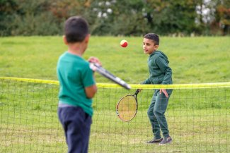 Children play tennis as part of Greenway Day 2017