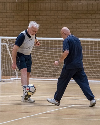 Men playing indoor walking football